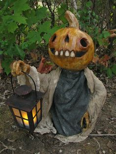 Pumpkin with lantern sculpture by Dave the Dead of The Shadow Farm
