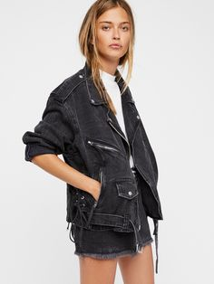 Oversized Denim Moto Jacket | Oversized denim moto jacket featuring front pockets with snap and zipper closures. * Front zipper closure * Belt buckle at the waist * Zipper accents on the sleeves