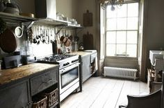 liking the rustic wood counter tops with the industrial ss-stove.