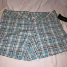 Southern Expression woven plaid shorts The color is blue / brown . 97% cotton ,3% spandex, size is xl . waist measures 38 inch waist . 43 inch hips 5 inch inseam Southern expression  Shorts