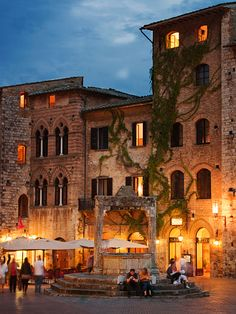 Piazza Duomo, the main square in the medieval town San Gimignano, a UNESCO Heritage site in Tuscany, Italy