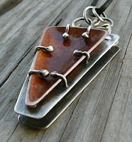 Handmade Jewelry by LjB....The balled prongs provide a decorative feature but it is the space in between elements that I especially appreciate.