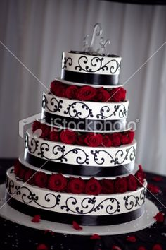 Google Image Result for http://i.istockimg.com/file_thumbview_approve/13956359/2/stock-photo-13956359-black-white-and-red-wedding-cake.jpg