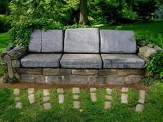 Looking for an unusual setting area for your garden? How about a Stone Garden Sofa. There is a matching chair too. Stones of varying sizes, some dirt to fill center, and your favorite cushions complete your sofa.