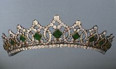 A diamond and square-cut emerald tiara with circa nine or more interlocking diamond motifs. Given by Henri de Orleans of France to his niece, Helene.
