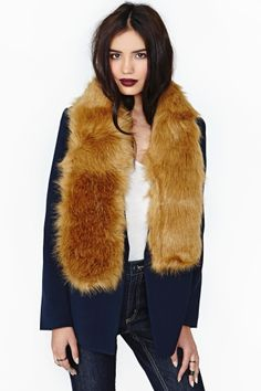 Faux fur scarf and dark lips. Mmm.