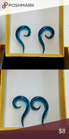 2g Blue glitter glass gauges/plugs EUC 6mm or 2g  Glass plugs Bought from fellow Posher but too small for me Make me an offer via the offer button  No PayPal  No trades  Smoke-free home Jewelry Earrings