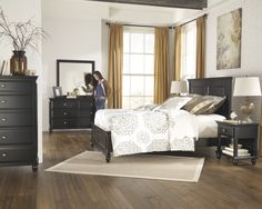 """The """"Owingsville"""" bedroom collection features a rustic black painted finish beautifully covering the thick moulding details and bevel drawer front design supported by stylish turned feet to create an inviting casual design that is sure to enhance the beauty and atmosphere of any bedroom décor."""