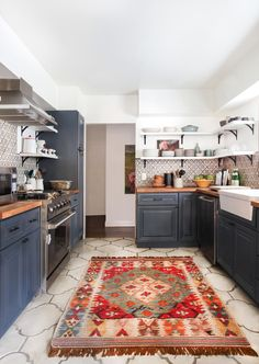 open shelving and cool painted cabinets