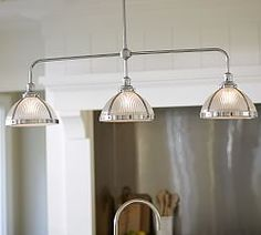 Just bought this for the cottage for over the stove since it is free standing : RIBBED GLASS TRIPLE PENDANT | Pottery Barn
