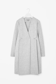 COS - $350 Made from a soft wool-blend, this long coat has a melange finish and structured feel of the fabric. A straight fit, it has oversized widenotched lapels, in-seam pockets and neat finishes. It is secured with a hidden button fastening.