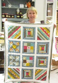 Karen with her beautiful sampler quilt. I hope that sewing machine is out of its locker and you're enjoying your adventure. Lockers, Blankets, Patches, Quilting, Scrap, Students, Adventure, Sewing, Pattern