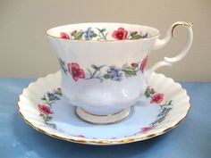 Pretty bone china tea cup and saucer by Royal Albert England. Ribbed design.Unusual blue and white pattern with red flowers. Pattern is unknown. No wear or stain. No chip or crack. | eBay!
