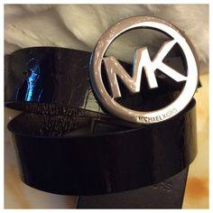 """Black MK belt Beautiful snake print black belt with polished silver logo buckle. Brand new and in perfect condition. Tagged as size M, 42"""" total length. Michael Kors Accessories Belts"""