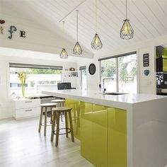 This kitchen design is one of our favourites. Love that yellow and hanging lights combo.  Paint: Resene Spotlight (yellow), Resene Black and Resene Quarter Merino (white). #Resene #habitatbyresene #homedecor #trends #fashiontrends #pastels #nzdesign #kitchen #style #interiordesign #interiorinspiration