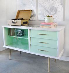 This vintage sideboard with mid century style was updated with paint, new hardware and gold accents. Learn how to do it yourself with the tips in this post.