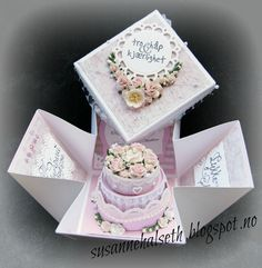 Beautiful cake in a box/explosion box template--may need to translate some of the instructions, but much of it is intuitive.
