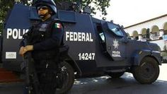 Over 30 Mexico cops nabbed in killing of fellows