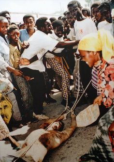Dead U.S. Soldier in Mogadishu by cliff1066™, via Flickr - I want every American to see this photo! These are the people we were sent in to help. This is how they show their appreciation....they are full of hate and all of them are EVIL