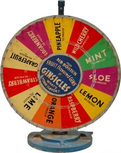 """Vintage Prohibition-Era GINSICLES Roulette Wheel by Ben-Burk Inc., Boston Mass. - """"Old Mr. Boston Fruit-Flavored Gins - Ginsicles - What's Your Flavor"""" in wheel center w/ various flavors & liquor proofs on wheel surround w/ metal pegs (ie. """"Loganberry 70 proof"""") - Cast-iron base - 18""""d wheel, 22""""h"""