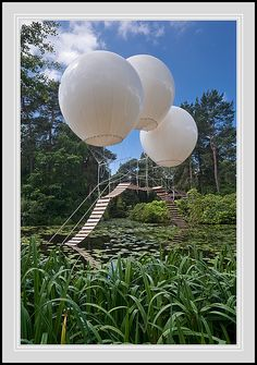 "Olivier Grossetête's 'Pont de Singe' at Tatton Park in England - photo by thenikonkid, via Flickr;  'Pont de Singe' is a floating bridge attached to helium balloons, thus taking literally the term ""suspension bridge."" (from Arch Daily)  ""There is no way on or off the bridge, which is held aloft by three helium-filled balloons. ... The work is offered as a meditation for those who wish to contemplate an impossible journey."" (from thenikonkid)"