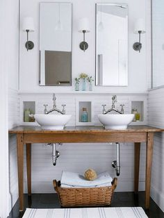 Refinish an antique table to serve as a sturdy but stylish bathroom vanity. Classic vessel sinks and bridge faucets complete this clean and simple cottage look./