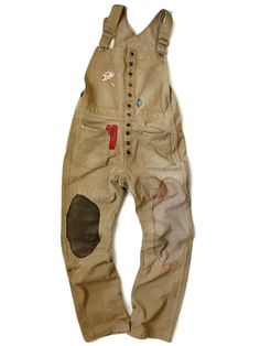 When Gran is working on her motorbike, she would wear these brown dungarees over her bright blouse. They would be covered in old flaky paint & blobs of grease.