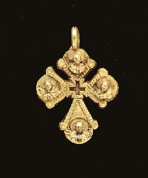 A BYZANTINE GOLD PENDANT CROSS   Circa 7th Century A.D.   Of 'Latin' type, with a deeply-recessed cross at the transverse, each arm with a medallion depicting the bust of a haloed saint in relief, all identified by Greek inscriptions, the sides of each arm with a ribbed border, IC XC in filigree on the reverse, a suspension loop above