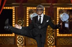 Actor Tommy Tune, recipient of the Lifetime Achievement Award, kicks in the air after being presented the award. REUTERS/Lucas Jackson