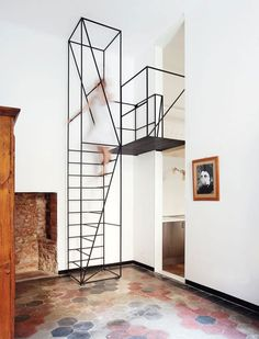 This metal staircase, designed by Francesco Librizzi Studio, sits in House C, a 1900s house in Milan that still has many original details. The staircase takes up little space in the small room and leads to a loft-like sleeping area.