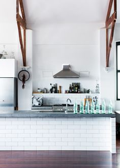 white subway tile kitchen with slate blue counter tops