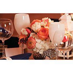 metal vases with orange/peach, white/cream, blush flowers