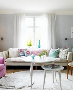 layered rugs, layered tables, layered pillows