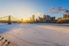 Beautiful golden rays shine over the frozen Allegheny in #Pittsburgh. Credit: Dave DiCello