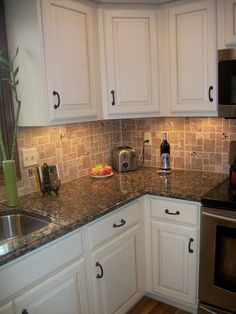 Baltic brown granite countertops are fairly consistent in coloration and the black-brownish background is complemented by rust and cream specks. Off White Kitchen Cabinets, White Cabinets White Countertops, Brown Granite Countertops, Off White Kitchens, Brown Kitchens, Kitchen Cabinet Colors, Kitchen Cabinetry, Kitchen Countertops, Kitchen White