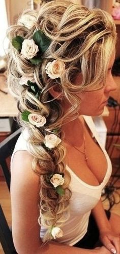 Bride's long loose fishtail braid bridal #hair ideas ToniK #Wedding #Hairstyles Few people will not be dazzled by a long haired bride walking down the aisle. There are few chances for a girl to shine in life which can compare with being a bride in a wedding.❤️
