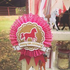 Lauren's Horse Party in hot pink, chocolate brown and gold: paper medallion with Martha Stewart punch edge {A Blissful Nest}