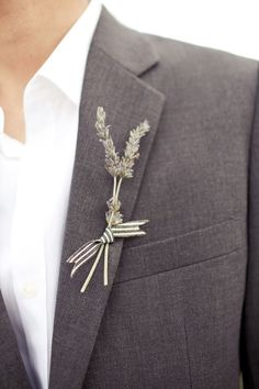 I really like the idea of lavender sprigs for boutonnière. Simple and sweet. I'd add some thin gold ribbon and use more vibrantly purple pieces.