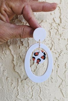 Large white oval hoops with animal print disc inside and white button top. Animal print disc made with polymer clay canes. These were fun to make. Cute Polymer Clay, Polymer Clay Charms, Handmade Polymer Clay, Polymer Clay Jewelry, Metal Clay Jewelry, Diy Clay Earrings, Ideas Joyería, Clay Beads, Clay Creations