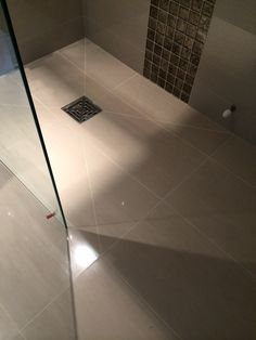 Wet room floor using polished lindos ivory porcelain www.ceramicatilesashtead.com #personalbydesign
