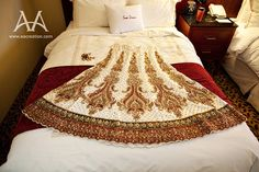 off-white lengha skirt with bold gold detailing