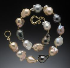 Baroque South Seas Necklace 18K, Peach Chinese freshwater pearls interspersed with Black Tahitian pearls.  Hughes-Bosca Jewelry | Necklaces