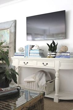 Painted console with TV hung above. Beautiful!
