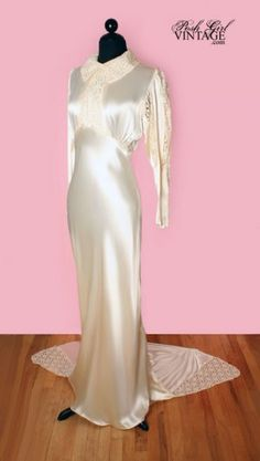 1930's Ivory Satin & Lace Art Deco Wedding Dress/Gown-M --Silky cream ivory satin in amazing rare condition & soft pale ivory lace give this dress a glamorous yet understated elegance. The top of the sleeves are full and puffy, it buttons in the back with satin covered original round buttons, and has a nice train with lace edges.  Sleeves taper and fit slim on the lower arm. Unlined. Art deco era wedding dress...Old Hollywood glamor.