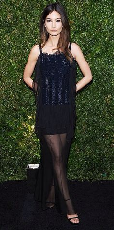 Lily Aldridge stunned at the Chanel Tribeca Film Festival Artists dinner, who fittingly chose a design from the brand—a navy sequined mini with a long sheer black overlay—that she styled with a silver clutch and black dainty ankle-strap sandals. Star Fashion, Fashion Outfits, Style Stealer, Chanel Outfit, Chanel Fashion, French Fashion Designers, Lily Aldridge, Celebrity Look, Celeb Style