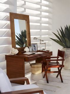 Modern, sunlit home office by the sea, featuring Ralph Lauren Home furnishings in cherry wood, mahogany and crushed bamboo