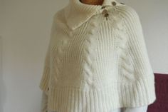 Esprit's poncho via Gaspard, Basile et Lulli. Click on the image to see more!
