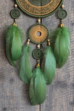 Dream catcher for lovers of green color. It combines army green and a bit mustard colours. This is my authors dreamcatcher. The design includes