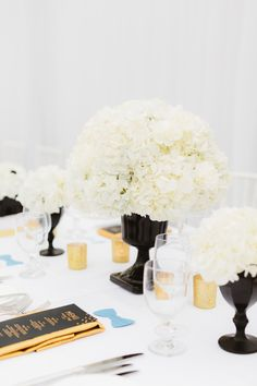 Wedding Centerpiece | Great Gatsby Inspired Wedding on Style Me Pretty: http://www.StyleMePretty.com/2014/02/18/great-gatsby-inspired-wedding-at-the-london-west-hollywood/ Photography: Erin Hearts Court