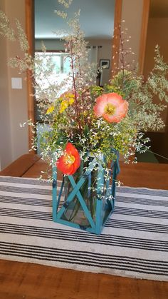 Garden Flower Arrangement in Lantern.  Feather reed grass, Dill flowers, coral bell flowers, yellow yarrow, Iceland poppies and diamond frost Euphoria.  Yellow House Landscape Design Bre Cotter